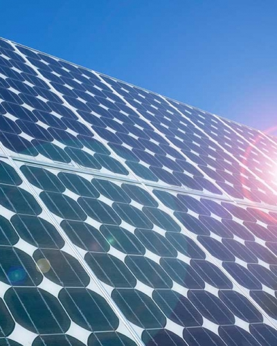 Photovoltaic-cells-solar-panels-lens-flare-cropped